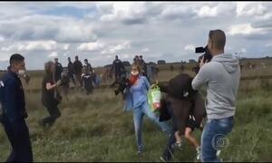 Cinegrafista derruba refugiado e criança durante confusão na Hungria