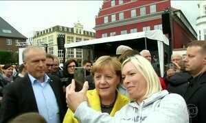 Angela Merkel segue na frente no último dia de campanha para eleições