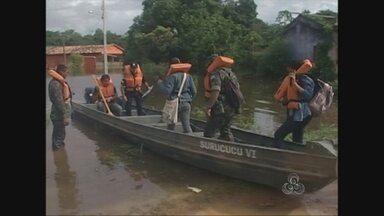 Bairros de Guajará-Mirim, RO, são monitorados por causa de enchente - Relatório será enviado a Defesa Civil Nacional para auxílio ao município.Estado de calamidade foi decretado na terça pelo prefeito de Guajará.