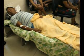 Profissionais denunciam falta de estrutura para atender pacientes no PSM do Guamá,em Belém - Sem leitos suficientes para todos, os doentes são atendidos onde é possível.