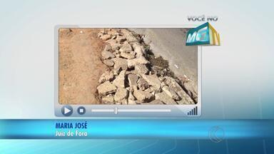 VC no MGTV: moradora denuncia buracos em passeios de Juiz de Fora - Nas fotos, Maria José mostra pedestres se arriscando na Avenida Presidente Itamar Franco, no Cascatinha. Secretaria de Atividades Urbanas informou que proprietários foram intimados a fazer o conserto.