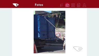 Caminhão passa e arranca fios elétricos em Cariacica, ES - Comerciantes e moradores ficaram sem energia elética. Dúnuncia foi feita pelo aplicativo da TV Gazeta.