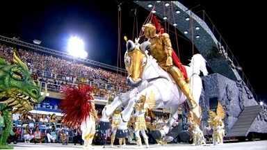 Estácio de Sá abre o desfile do Grupo Especial no Rio com homenagem a São Jorge - A Estácio de Sá abriu o desfile do Grupo Especial na Marquês de Sapucaí. E na volta à elite do carnaval carioca, homenageou um dos santos mais queridos de cariocas e brasileiros: São Jorge.