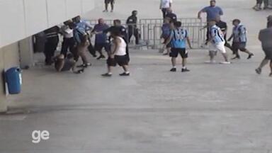 Câmera de segurança flagra briga entre torcidas na Arena do Grêmio - Assista ao vídeo.