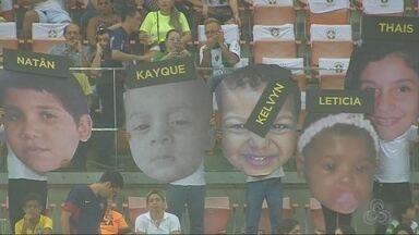 Ação para localizar crianças desaparecidas é realizada na Arena da Amazônia - Ato ocorreu durante jogo Brasil X Colômbia, em Manaus.