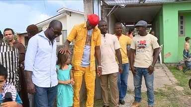 Haitianos fazem celebração de Natal para unir culturas no Sul de Santa Catarina - Haitianos fazem celebração de Natal para unir culturas no Sul de Santa Catarina