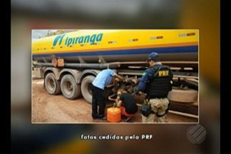 Motorista e borracheiro são flagrados furtando diesel de caminhão tanque em Aurora do Pará - Os dois suspeitos foram presos na BR-010. Esta é terceira vez que a PRF flagra desvio de combustível no mesmo local.