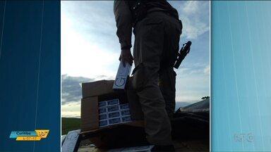 Caminhoneiro é preso por transportar 450 mil carteiras de cigarro contrabandeadas - O flagrante da polícia federal foi na BR-376, em Tibagi. O cigarro era contrabandeado do Paraguai.