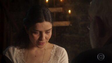 Delfina interroga Padre João sobre a presença das Irmãs na paróquia - Ela diz que elas foram lá buscar doações e só
