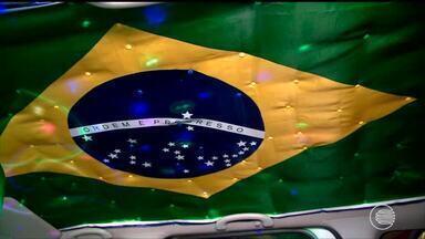 Clima de Copa do Mundo toma conta da cidade e muda cotidiano do comércio - Clima de Copa do Mundo toma conta da cidade e muda cotidiano do comércio