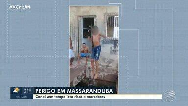 Perigo: jovem pula em canal sem tampa no bairro de Massaranduba, em Salvador - A reportagem foi ao local conferir o problema. Envie sua denúncia para jm@redebahia.com.br.