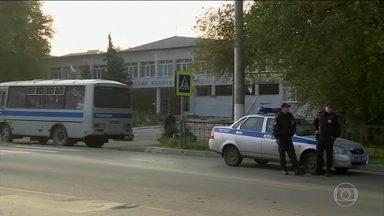 Sobe para 21 o número de mortos em ataque à escola na Crimeia - Imagens de uma câmera de segurança mostram o atirador comprando munição, dias antes do ataque.