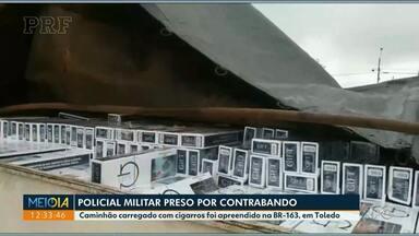 PM é preso em Toledo depois de 'escoltar' contrabandista de cigarros - O policial ia na frente do caminhoneiro, que levava cigarros contrabandeados do Paraguai.