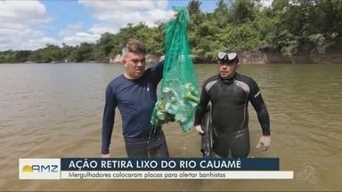 Grupo de mergulhadores realiza ação de conscientização ambiental em Boa Vista - Mergulhadores colocaram placas para alertar banhistas.