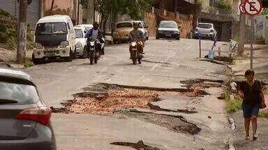 Buracos se multiplicam nas ruas de Juiz de Fora e são agravados com chuvas - Equipe do MG1 encontrou crateras que impedem a passagem de carros e assustam moradores. Prefeitura se manifestou sobre problemas.