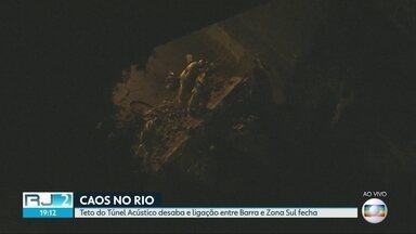 Teto do Túnel Acústico desaba e ligação entre Barra e Zona Sul fecha - Após a interdição da Avenida Niemeyer por causa das chuvas, parte do teto do Túnel Acústico desabou. O Rio perdeu as principais ligações entre as zonas Sul e Oeste. Equipes trabalham para remover os escombros e liberar a passagem.