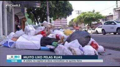 Lixo ainda está nas ruas de Belém, mesmo após retorno do serviço - Filas de caminhões foram registradas na entrada do Aterro Sanitário de Marituba.