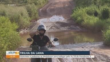 Buraqueira limita tráfego e causa prejuízos a moradores do bairro Marabaixo 3 - Crateras ocupam toda a extensão da Avenida 18.