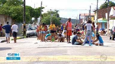 Ruas de bairro na Zona Norte de Aracaju são enfeitadas com tapetes de Corpus Christi - Data é uma celebração do mistério da eucaristia.