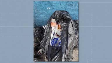 Material escolar novo é jogado no lixo em Nova Iguaçu - O caso aconteceu na Escola Municipal Monteiro Lobato, no centro de Nova Iguaçu. A prefeitura diz que abriu uma sindicância e afastou a diretora da escola.