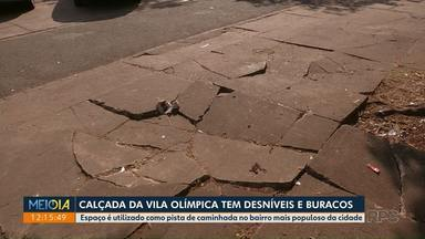 Calçada da Vila Olímpica tem desníveis e buracos - Local é utilizado como pista de caminhada por moradores da Zona 7.
