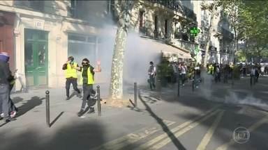 Passeata pelo clima em Paris termina em confrontos - Grupos mascarados e coletes amarelos, que protestam contra o governo francês, se infiltraram em ato em defesa do meio ambiente. Polícia usou bombas de gás lacrimogêneo.