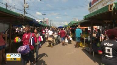 Comerciantes usam o bom humor para conquistar clientes em feira de Boa Vista - Cada feirante usa uma tática diferente para tentar vender mais.