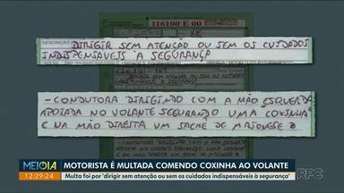Motorista é multada ao dirigir comendo coxinha - A multa descreveu com detalhes a infração registrada em Ponta Grossa.