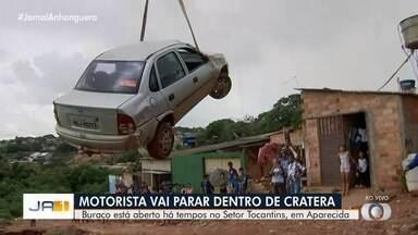 Carro é removido de dentro de cratera em Aparecida e Goiânia - Motorista caiu no local após perder a visão momentaneamente por causa da luz.
