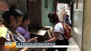 Moradores de Paraisópolis ganham ovos de chocolate nesta quinta (9) - A entrega está sendo feita pelos 420 presidentes das ruas.