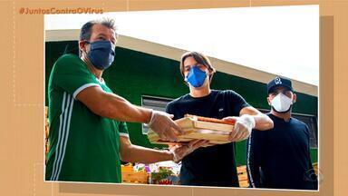 Dunga, Geromel, Maicon, Paulo Miranda e Paulo Victor distribuem 15 toneladas de alimentos - Assista ao vídeo.