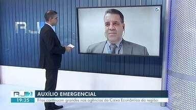 Superintendente da Caixa Econômica Federal fala sobre filas nas agências do Sul do Rio - Filas tem sido provocadas pelo grande número de pessoas que vão às agências para sacar o auxílio do governo.