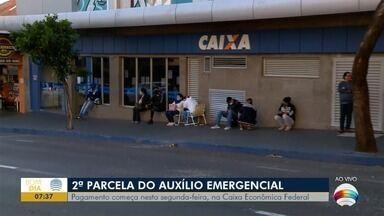 Começa pagamento da 2ª parcela do auxílio-emergencial - Busca por informações tem causado filas na Caixa Econômica.