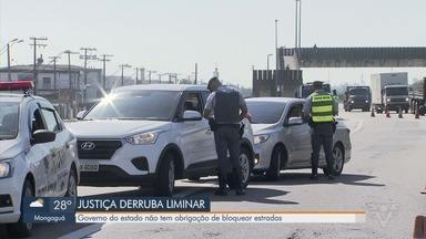 Justiça derruba liminar que permitia bloqueio de rodovia de acesso ao litoral de SP - Governo do Estado não tem obrigação de bloquear estradas neste período.