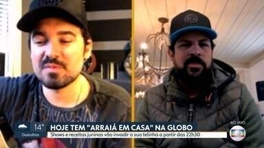 """Globo faz """"Arraiá em Casa"""" com cantores sertanejos - Programação inclui receitas típicas juninas e destaca show com a dupla Fernando & Sorocaba"""
