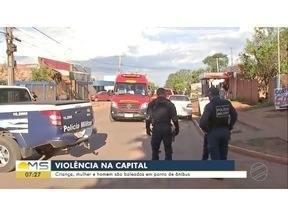 Criança, mulher e homem são baleados em ponto de ônibus - Criança, mulher e homem são baleados em ponto de ônibus