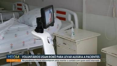 Voluntários usam robô para levar alegria a pacientes - Na pandemia eles se reinventaram para manter o contato com quem está internado.