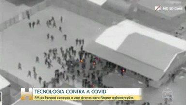 Drone com câmera térmica da PM do Paraná flagra festa com algomeração - As imagens mostram pessoas tentando fugir do local durante a abordagem. Evento descumpria decreto estadual contra a Covid-19. Quatro pessoas foram presas.