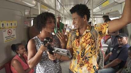 O Vumbora pega trem no subúrbio ferroviário para Itacaranha, onde conhece alguns artistas