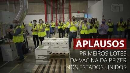 Funcionários da Pfizer aplaudem saída dos primeiros lotes de vacina da fábrica
