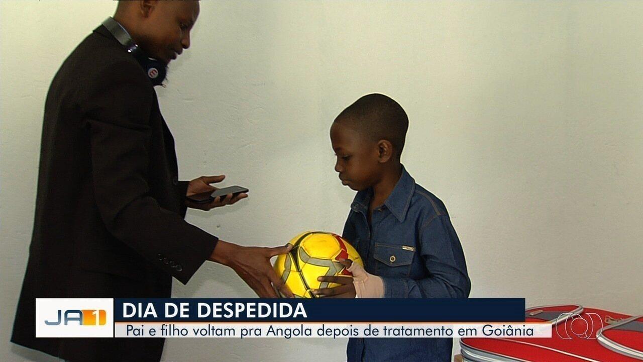 Após tratamento contra tumor em Goiânia, menino volta com o pai para a Angola