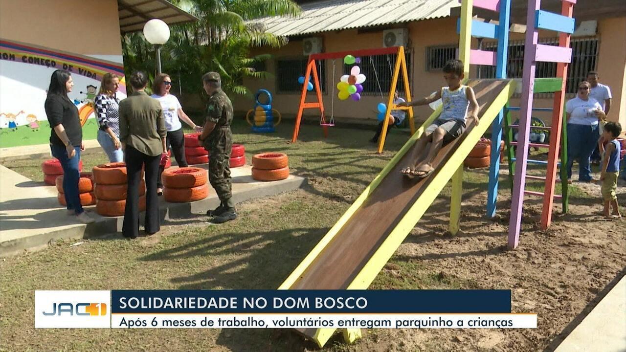 Após seis meses de trabalho, voluntários entregam parquinho a crianças do Dom Bosco